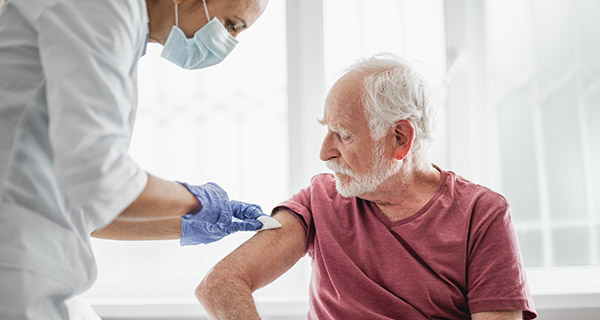 Man getting vaccine in arm