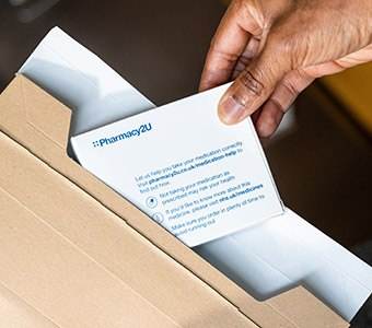 Removing prescription items from a cardboard envelope