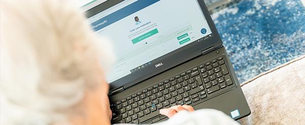 Older lady ordering her medication on her laptop