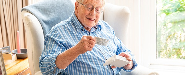 Older man opening his medication