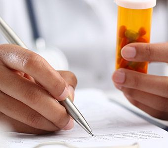 Close up of prescription being filled out