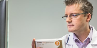 Superintendent Pharmacist Phil Day checking a prescription