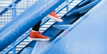 Close up on feet of person climbing stairs