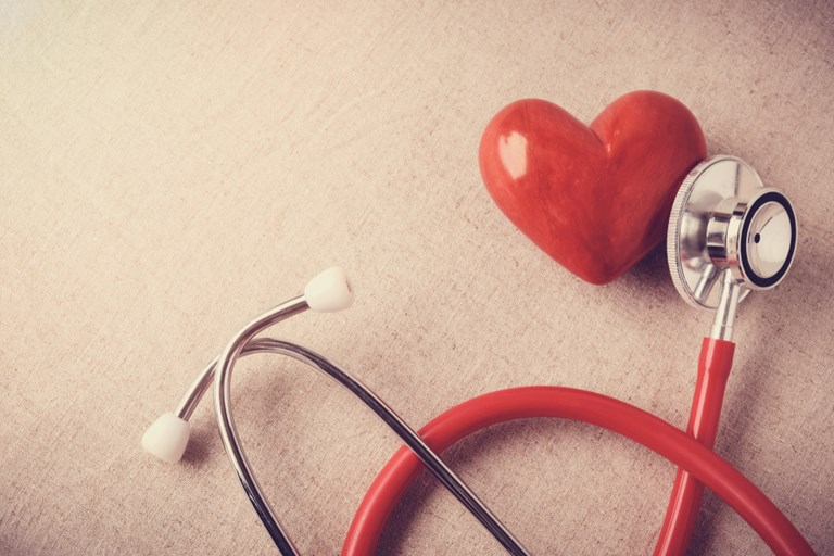 red heart with stethoscope, heart health, health insurance concept, world health day, doctor day, world hypertension day